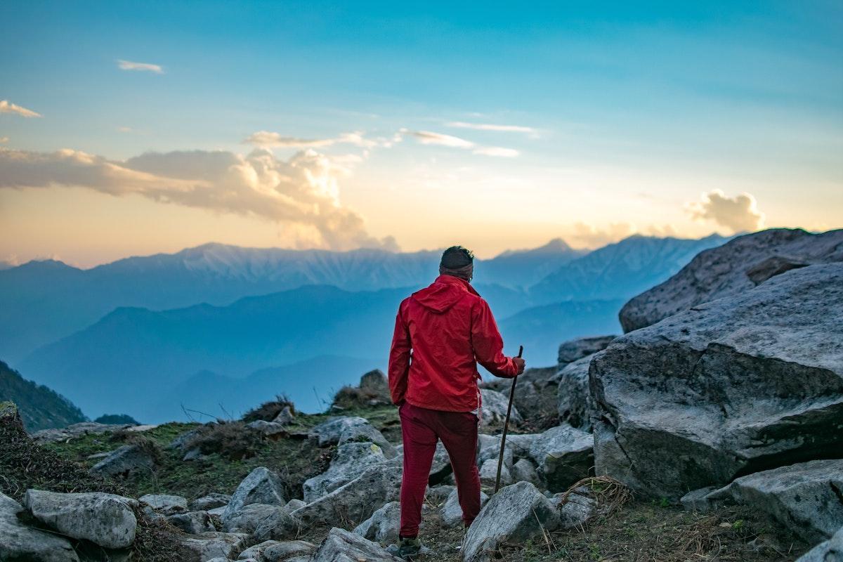 Man in membrane jacket, mountains